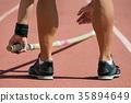 Pole vaulter prepares for jump 35894649