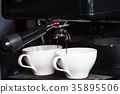 Coffee machine making two cup of fresh espresso 35895506