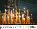 Church candles at dark background 35899067
