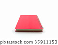 Red diary book on white background. 35911153