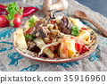 Traditional stew with lamb chops and vegetables 35916960