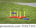 Ring throw summer game on a green lawn 35927305
