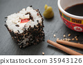 maki and chopsticks on chalkboard background 35943126