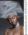 Beautiful african girl with veil hat 35953337