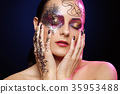 beautiful woman with bright makeup with glitter 35953488