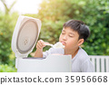 Asian boy and rice cooker 35956668