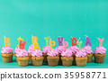 pink cup cake with happy birthday candle 35958771