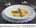 Creamy soup with fish fillet and mussels 35968664