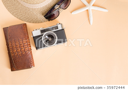Film camera and hat on a white background 35972444