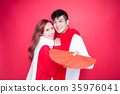 couple holding red envelope 35976041