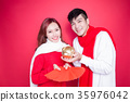 couple hold pig and envelope 35976042