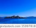 Gunkanjima and blue sky Gunkanjima cruise 35997818