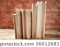Old books stacked in a row 36012683