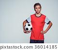 Photo of teen boy in sportswear holding soccer ball 36014185