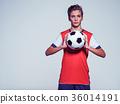 Photo of teen boy in sportswear holding soccer ball 36014191