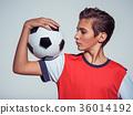 Photo of teen boy in sportswear holding soccer ball 36014192