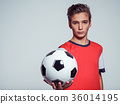 Photo of teen boy in sportswear holding soccer ball 36014195