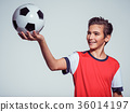 smiling teen boy in sportswear holding soccer ball 36014197