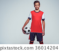 Photo of teen boy in sportswear holding soccer ball 36014204