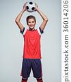 smiling teen boy in sportswear holding soccer ball 36014206