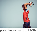 Photo of teen boy in sportswear holding soccer ball 36014207