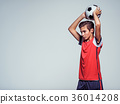 Photo of teen boy in sportswear holding soccer ball 36014208