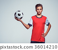 Photo of teen boy in sportswear holding soccer ball 36014210