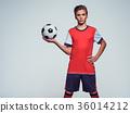 Photo of teen boy in sportswear holding soccer ball 36014212