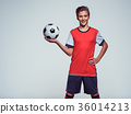 smiling teen boy in sportswear holding soccer ball 36014213