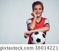 smiling teen boy in sportswear holding soccer ball 36014221