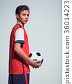 Photo of teen boy in sportswear holding soccer ball 36014223