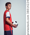Photo of teen boy in sportswear holding soccer ball 36014224