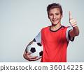 smiling teen boy in sportswear holding soccer ball 36014225