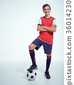 Photo of teen boy in sportswear holding soccer ball 36014230