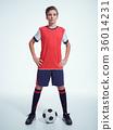 Photo of teen boy in sportswear holding soccer ball 36014231