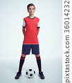 Photo of teen boy in sportswear holding soccer ball 36014232