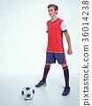Photo of teen boy in sportswear holding soccer ball 36014238
