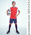 Photo of teen boy in sportswear holding soccer ball 36014241
