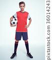 Photo of teen boy in sportswear holding soccer ball 36014243