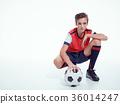 Photo of teen boy in sportswear holding soccer ball 36014247