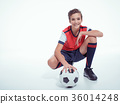 smiling teen boy in sportswear holding soccer ball 36014248