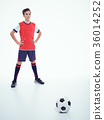 Photo of teen boy in sportswear holding soccer ball 36014252