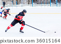Young skater man in attack. Ice hockey game 36015164