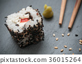 maki and chopsticks on chalkboard background 36015264