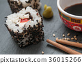 maki and chopsticks on chalkboard background 36015266