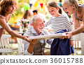 Family celebration or a garden party outside in 36015788