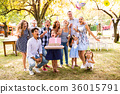 Family celebration or a garden party outside in 36015791