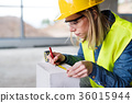 Young woman worker on the building site. 36015944