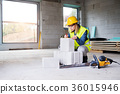 Young woman worker on the building site. 36015946