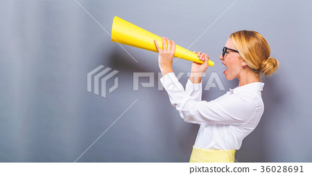 Young woman holding a paper megaphone  36028691